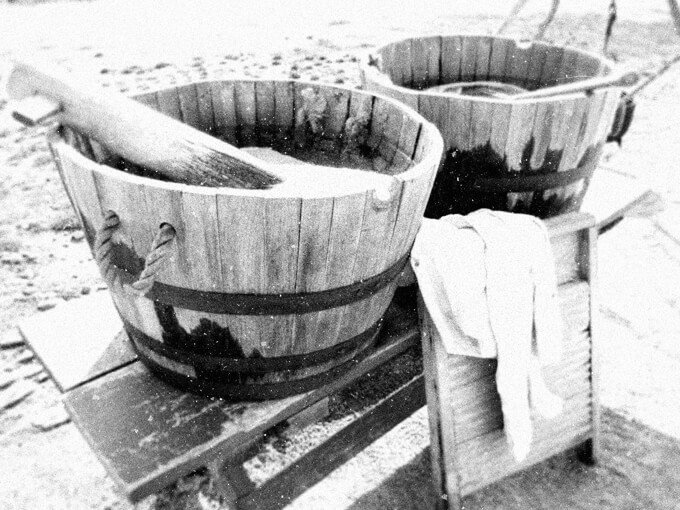 Laundry in Victorian times: These are an authentic washboard and washtubs but is a modern photo.